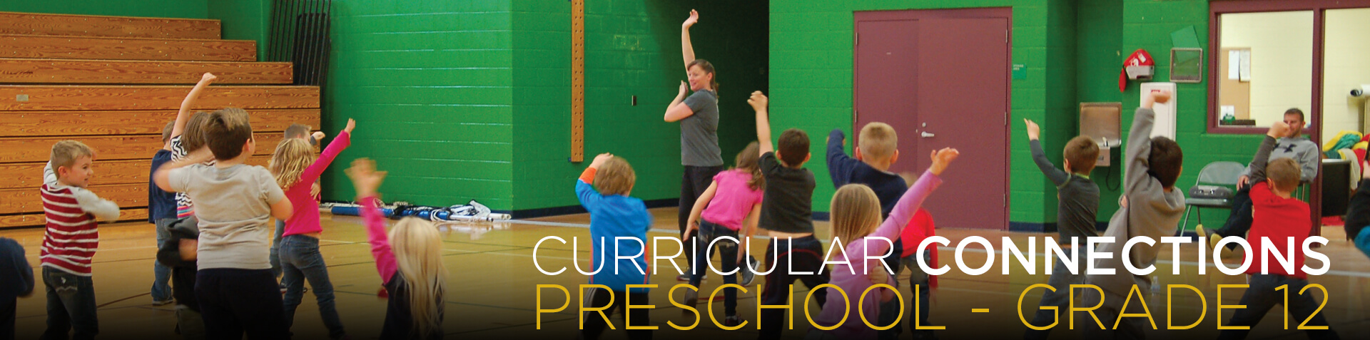 Curricular Connections Preschool through Grade 12. Image of young students on stage.