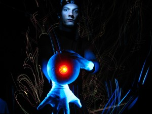Alvin Sputnik holding red glowing ball