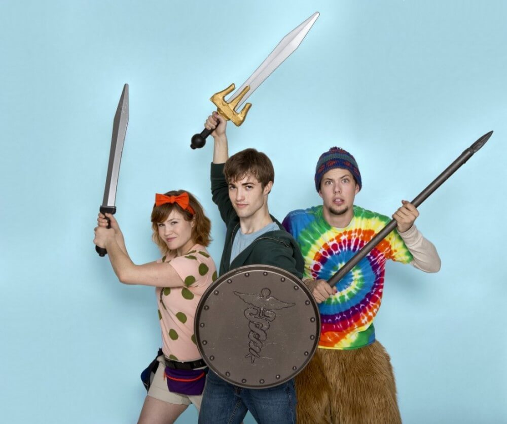 the lightning thief brings the book to life on stage at  the three main characters from the lightning thief stand their weapons