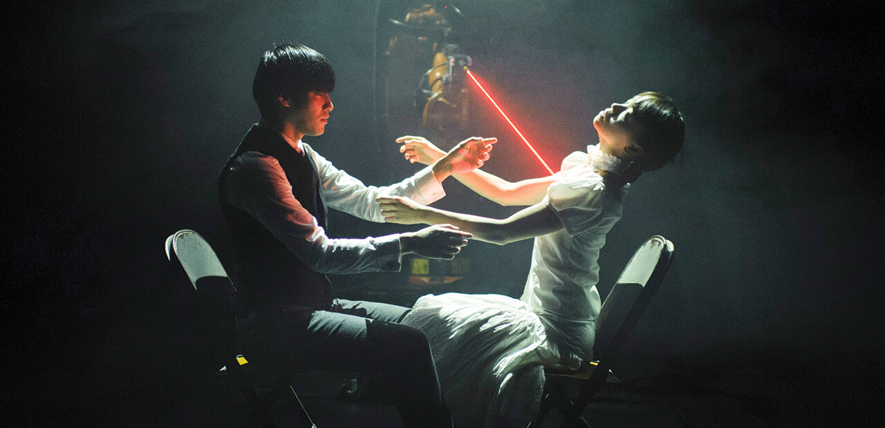 Huang Yi painstaking programs his robotic arm, KUKA, to dance along with him