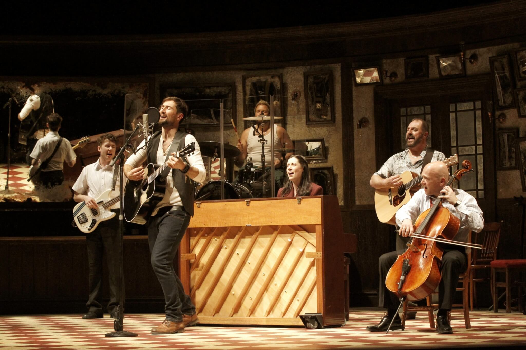 Cast of Once playing instruments