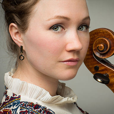 Close up of Ashley Bathgate holding her cello