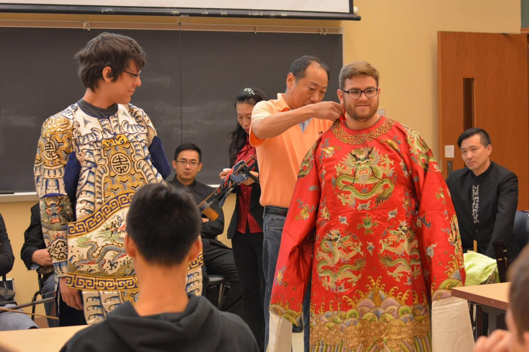 Members of Shanghai Jingju Theatre Company dress Purdue students in Peking Opera costumes