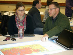 Professionals studying watershed maps, web based tool Tipping Points and Indicators.