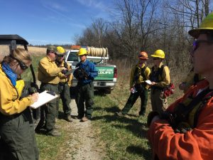 Group gathered for safety briefing before fireburn to restore grasslands.
