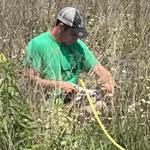 Cody Widner doing a prairie survey