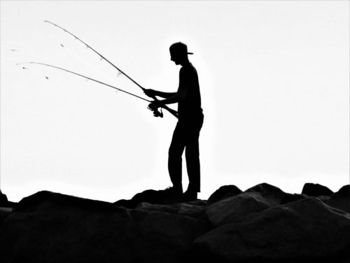 man with fishing poles