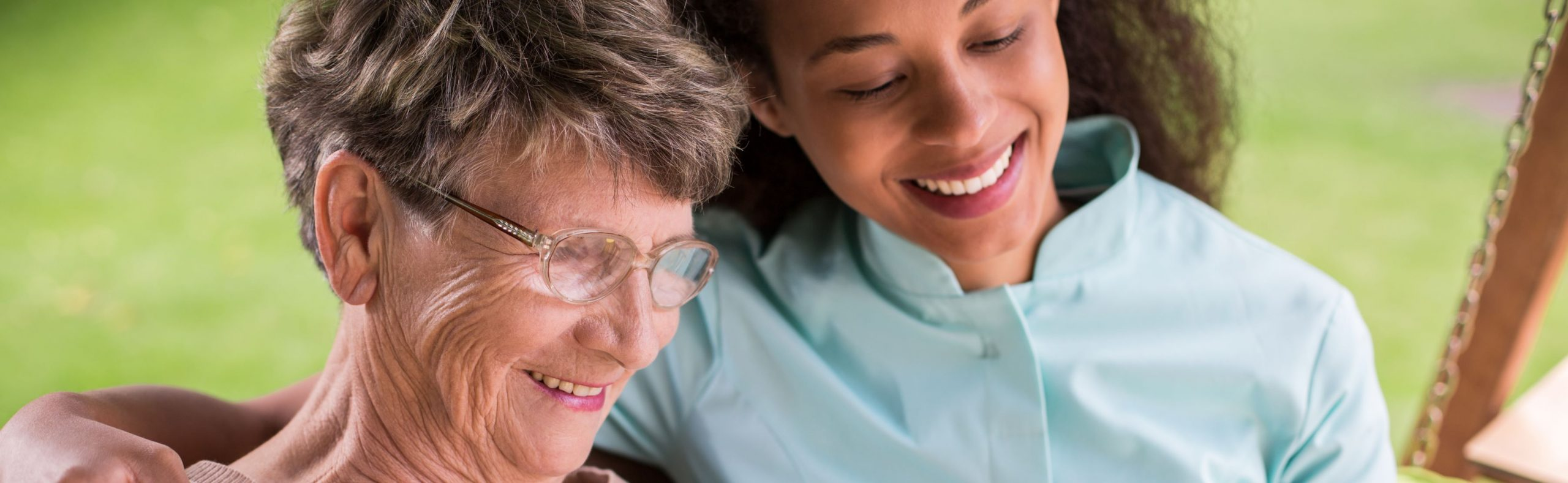 Caregiver assisting a retired person a long-term care facility.