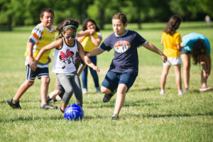 PALS campers playing soccer