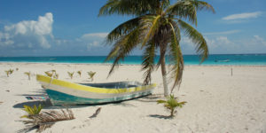 Boat on the beach: Americans have 705 million unused vacation days