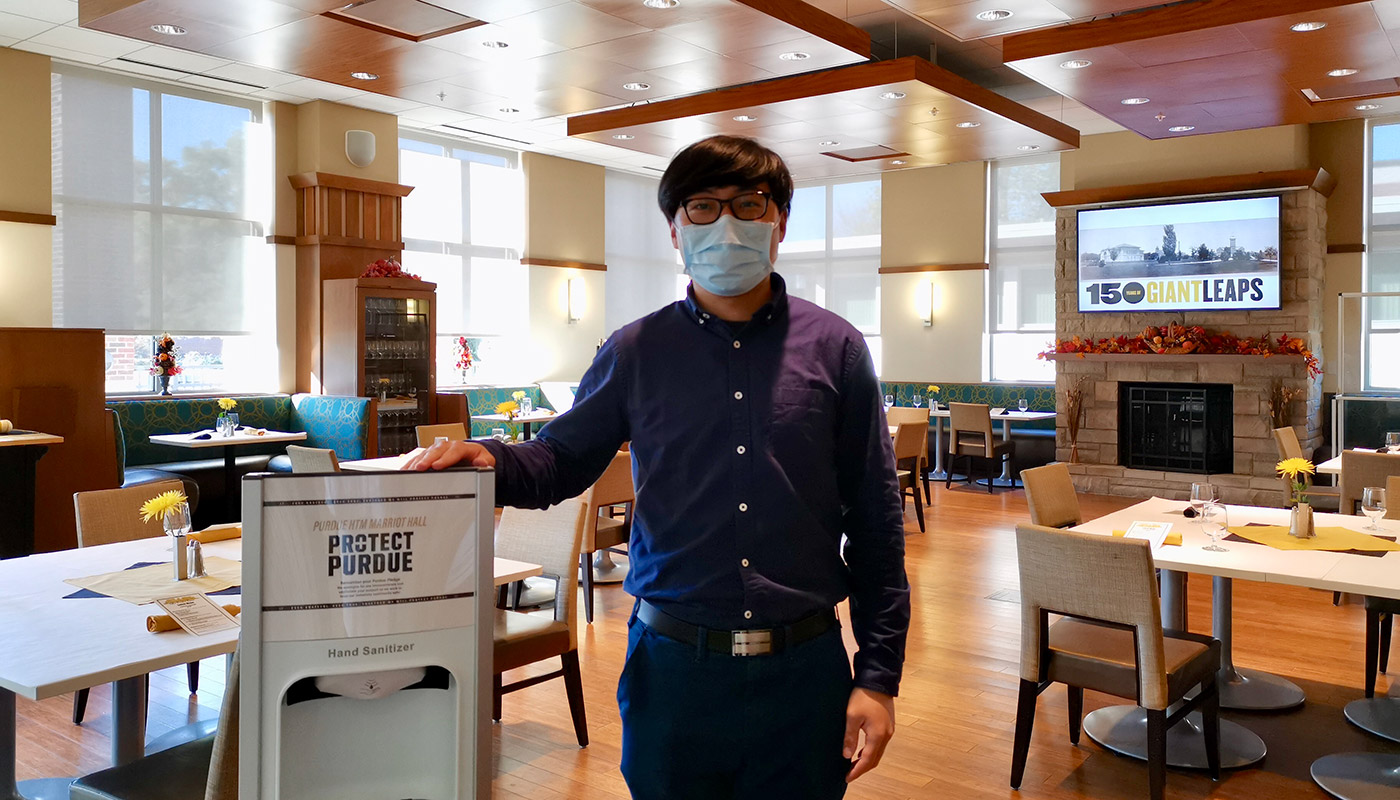 Yiran Liu, a 2nd-year PhD student in Hospitality and Tourism Management, works as a TA in the John Purdue Room, a restaurant and teaching lab that was temporarily closed in the spring of 2020 due to the pandemic.
