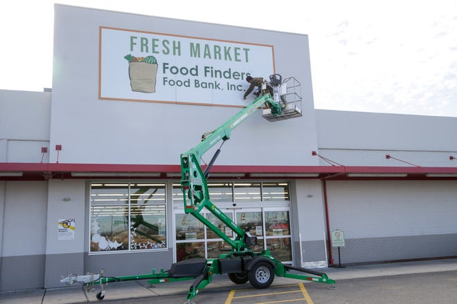 Fresh Market sign installation