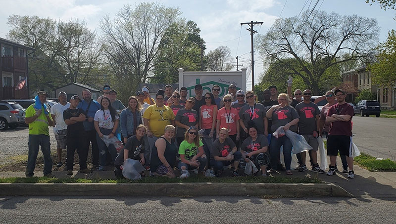 """During her internship, senior Gabby Palazzolo volunteers alongside her Home With Hope coworkers and clients as they completed a """"Clean Sweep"""" service activity to give back to the community. (Photo provided)"""
