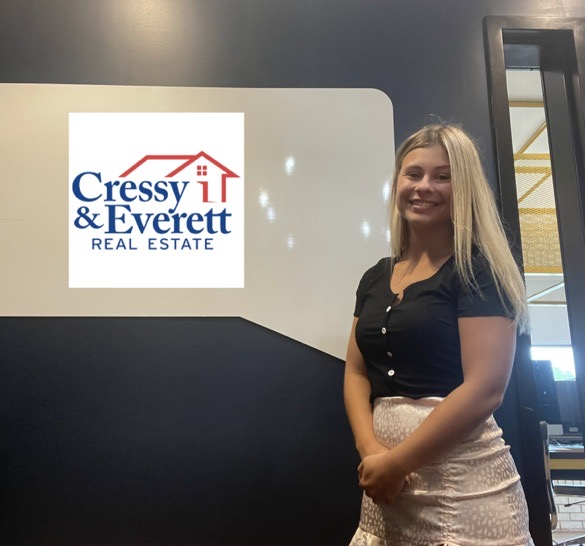 Katie Loring, a senior majoring in Sales and Sales Management, poses for a photo at her internship at the Cressy & Everett Real Estate office in South Bend, Indiana.