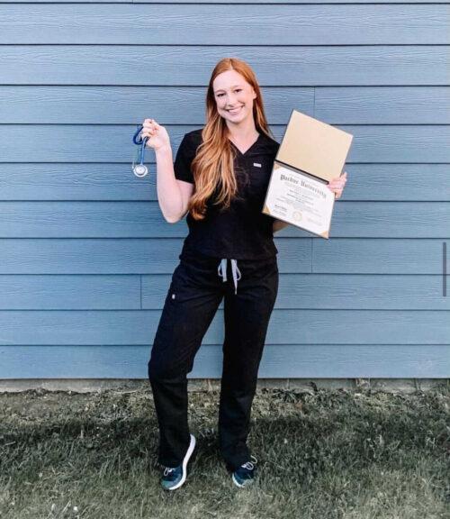 Hannah McKinney holds her diploma