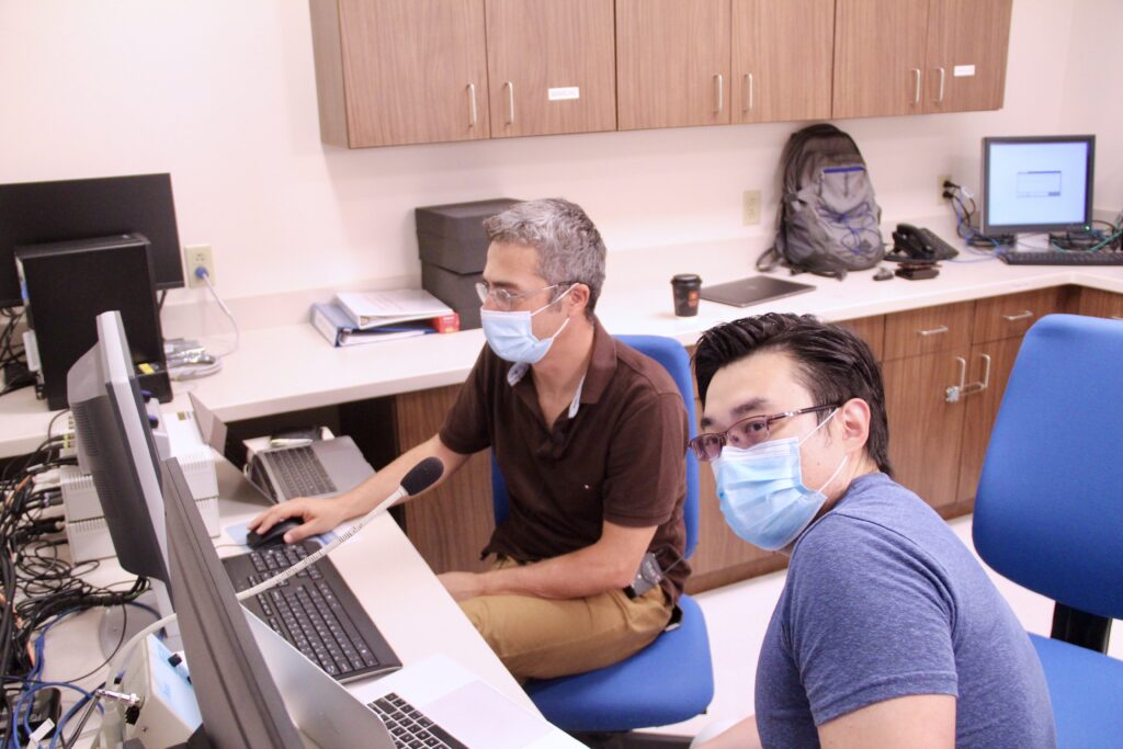 Uzay Emir and Xin Shen work in the Purdue Life Science MRI Facility.