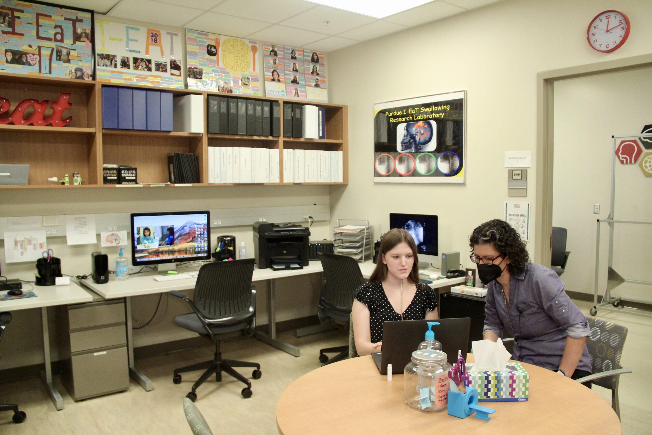 Georgia Malandraki and graduate student Jennine Bryan work in the I-EaT Lab.