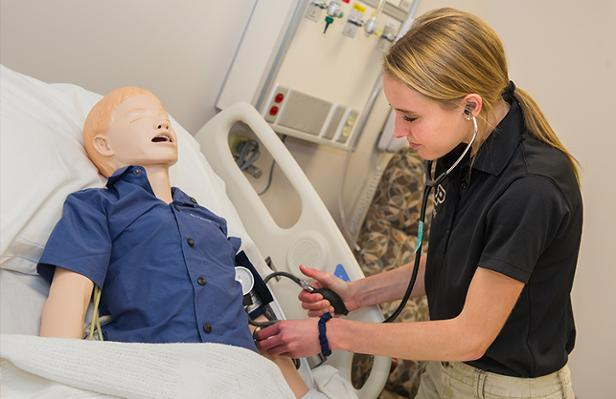 aba83c2b8c2 Sophomore Shannon Roberts works with a simulator manikin. (Photo by Rebecca  Wilcox)