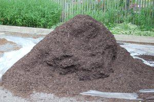A large pile of hardwood bark mulch