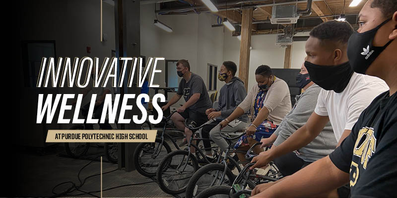 Students from Purdue Polytechnic High School Schweitzer Center at Englewood test out a bike simulator program through a partnership between Purdue's Center for Health Equity and Innovation and Nine13sports.