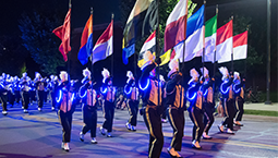 studyings marching with international flags
