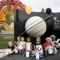 Preschoolers at VOSS (Visit Our Solar System) exhibit