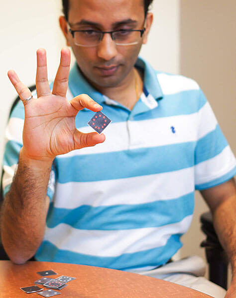 Mohit Verma displays the biosensor technology used to develop his rapid response COVID-19 tests.