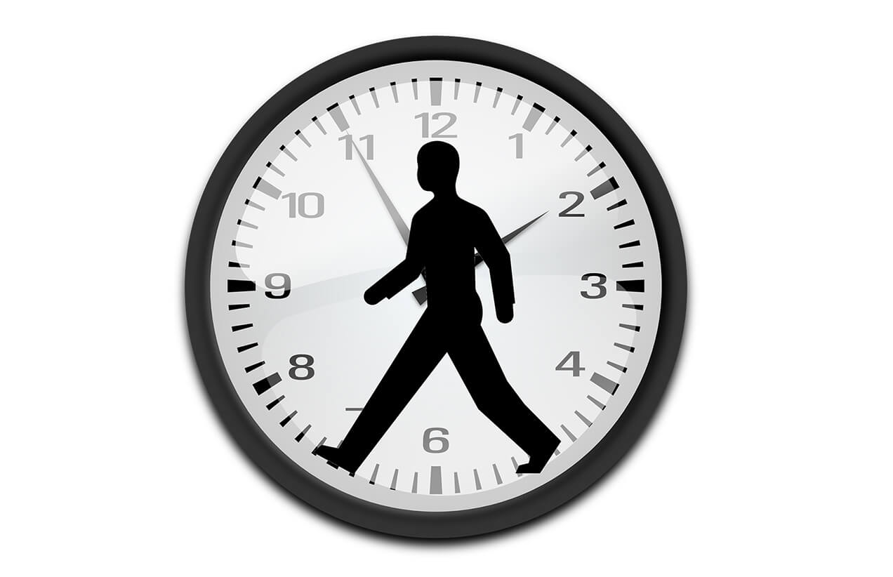 Man's silhouette over clock