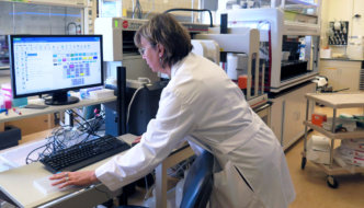 lab manager working with equipment