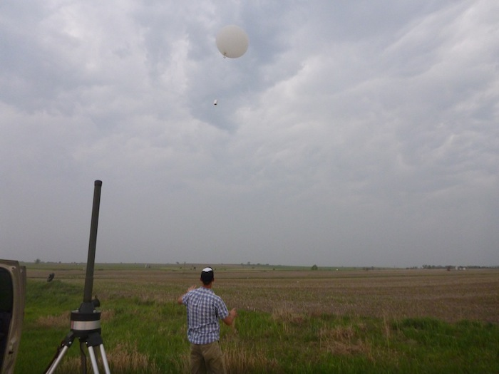 A weather balloon soars before an Oklahoma storm.