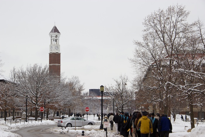 Students march to Elliott Hall in freezing winter weather.