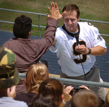 Drew Brees greets campers