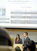 Kristeen Hudson and Brian Paplaski outline their companys strategies for success on Tuesday (Feb. 24) during Purdues 22nd annual Burton D. Morgan Business Plan Competition. Mission MatchUp claimed the $20,000 first prize in the Black Division for Purdue undergraduate students, while Microfluidic Innovations won the $30,000 first prize in the Black Division for Purdue graduate students. The final five presentations in each category were picked from an initial lineup of 68 student-led proposals. Prize money totaled $100,000 for what is the nations third longest-running student business plan competition. (Purdue News Service photo/Andrew Hancock)