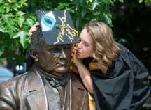 Graduate with John Purdue statue