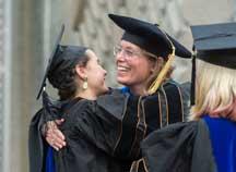 New graduates hugs