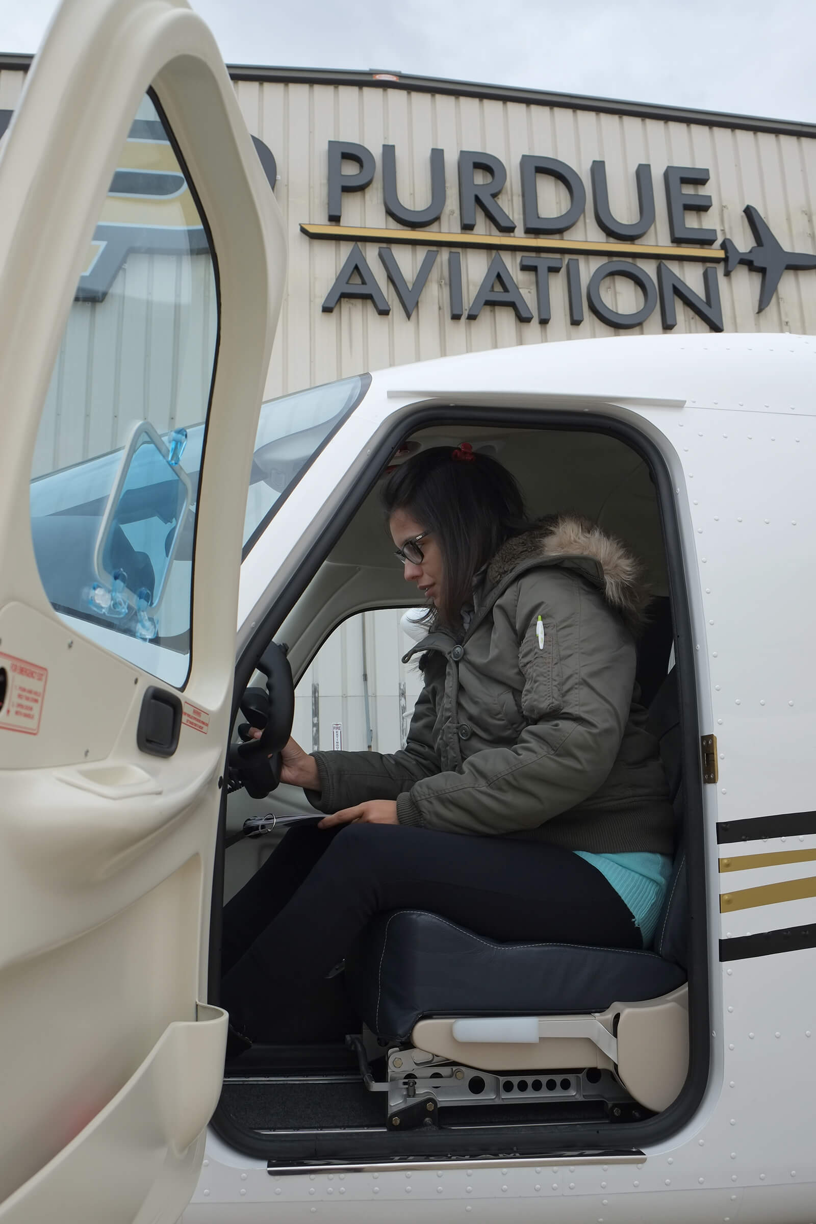 Poonam Guar A TECNAM Aircraft Dealer From India Practices Preflight Procedures On Purdue Aviation LLCs P2006T Twin Engine