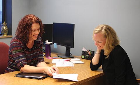 Rose Mason and Mandi Rispoli looking at papers