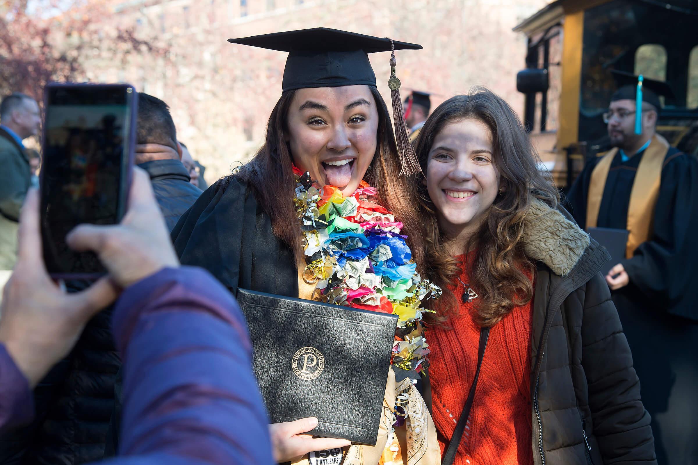 Graduate displays diploma