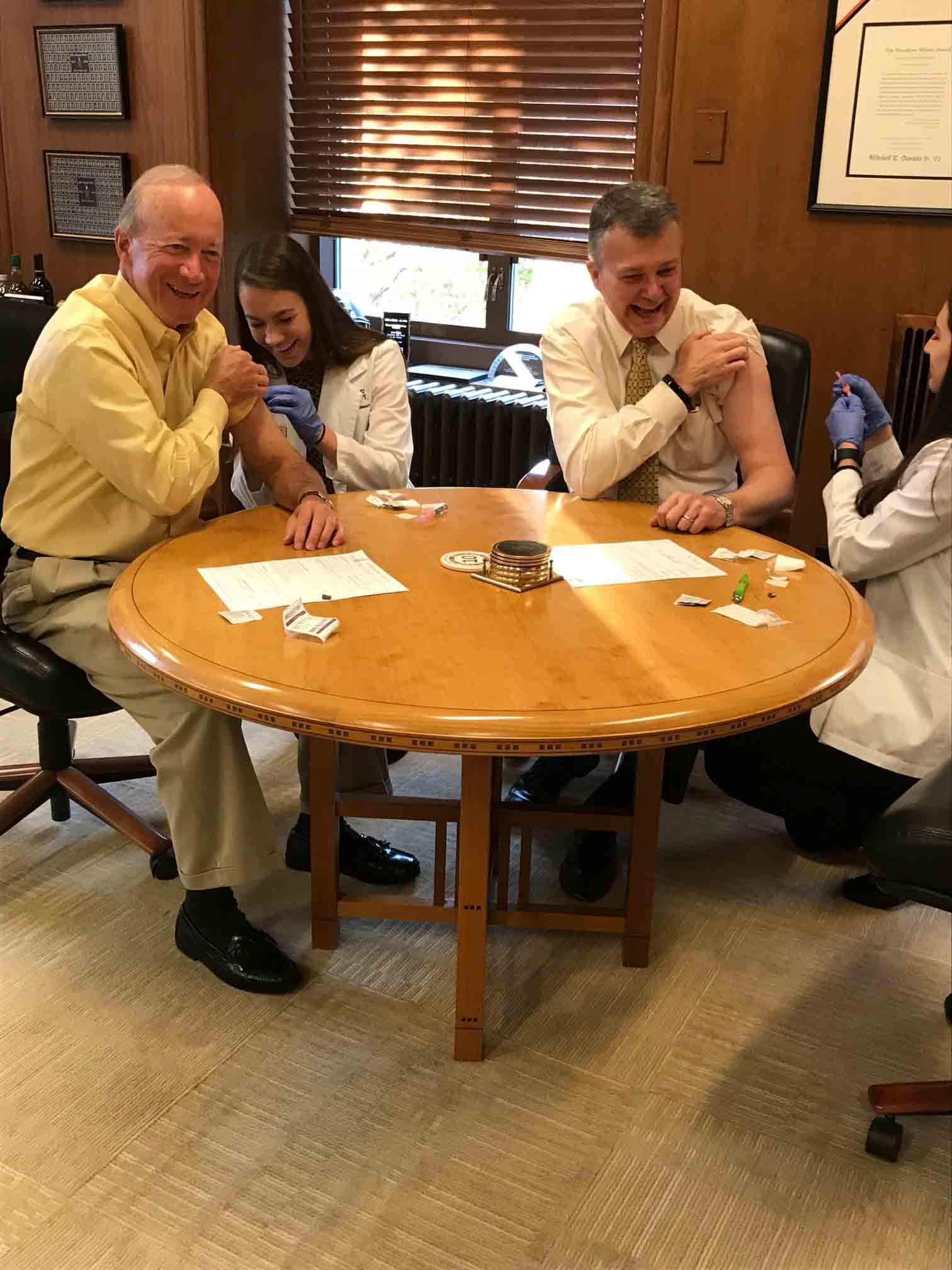 Mitch Daniels and Jay Akridge receive flu shots