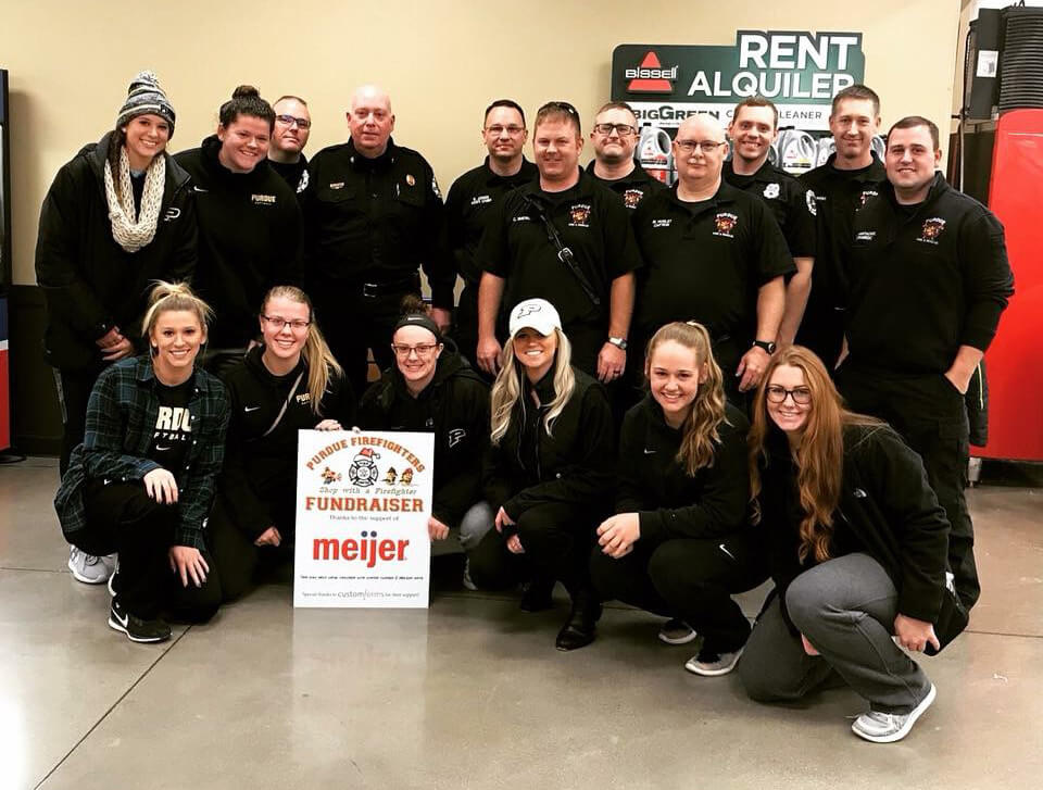 Members of Purdue University Fire Department and Purdue softball