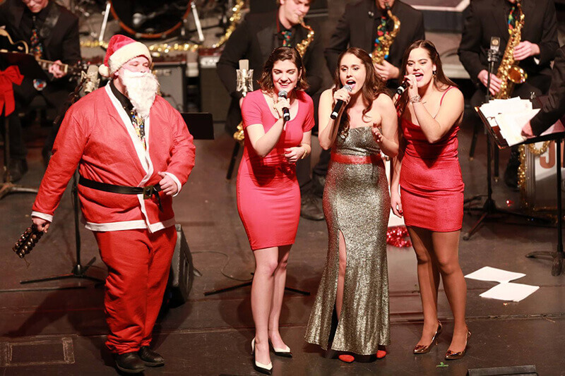 Jazz band with three female singers and Santa