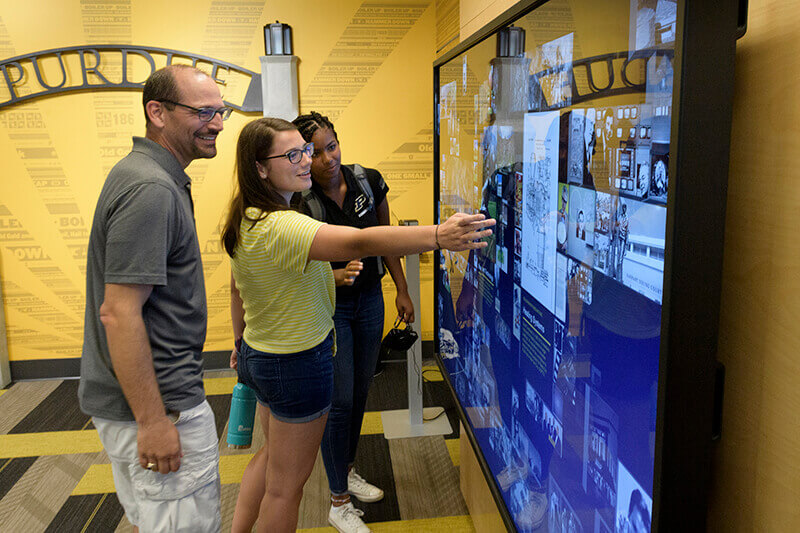 Visitors using touchscreen display