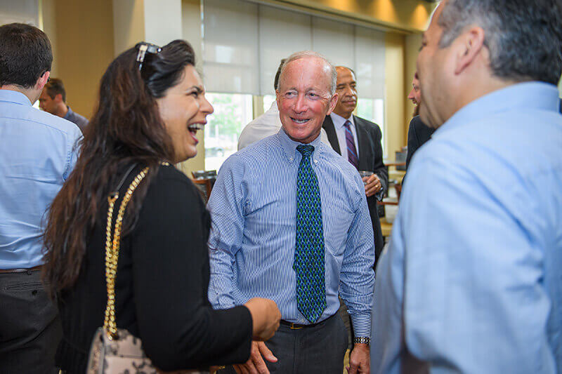 Mitch Daniels conversing at new faculty reception
