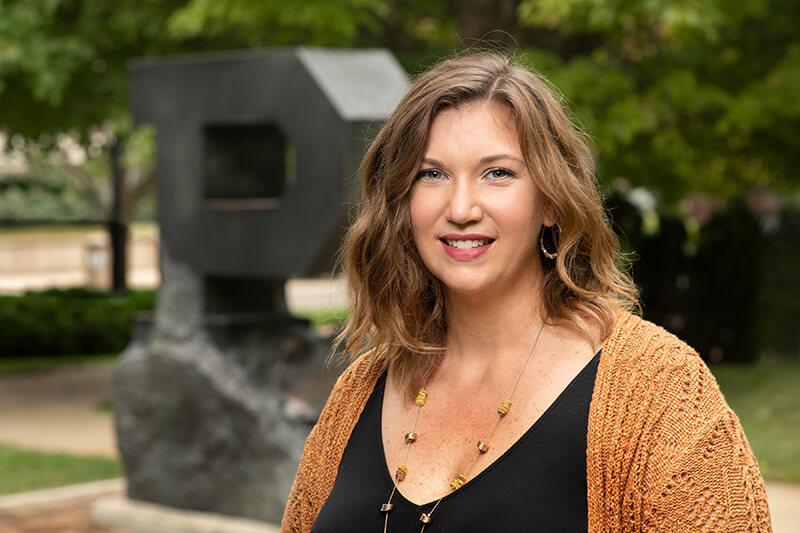 Sara Mellady at Unfinished Block P sculpture