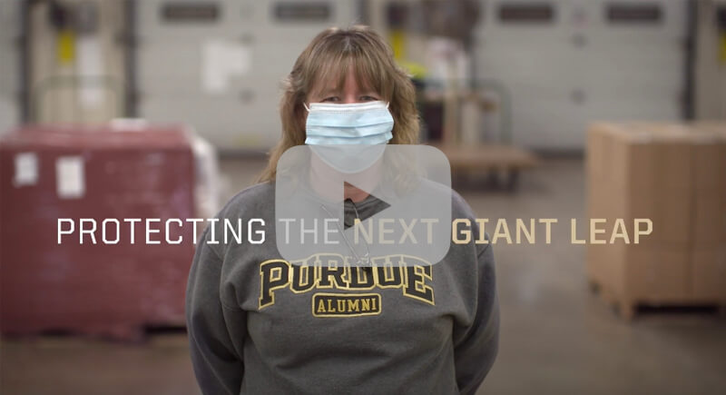 Purdue worker wearing a mask