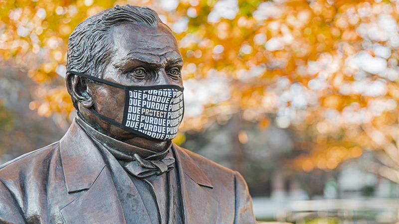 John Purdue statue, masked