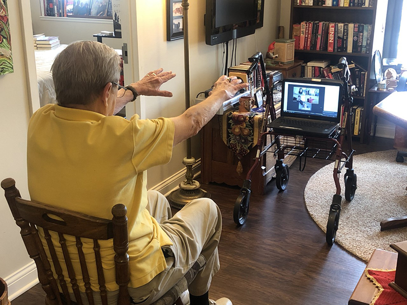 Student leads Westminster Village resident in an exercise session via telehealth